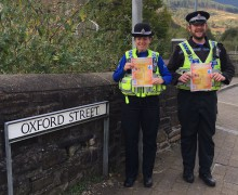 PCSOs Lucy Barry and Gareth Stoneham promote the Garw Valley Voice initiative while on partrol