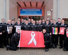Police constables holding the White Ribbon Flag