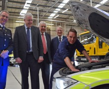 Chief Constable Peter Vaughan, First Minister Carwyn Jones, Council Leader Mel Nott, Police & Crime Commissioner Alun Michael and Mechanic Phil Evans at the new Joint Vehicle Maintenance Facility